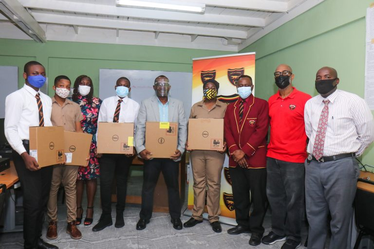 Mr. Michael Ellis, Principal of Cornwall College  (center) flanked by students and other representatives receiving the well needed machines.