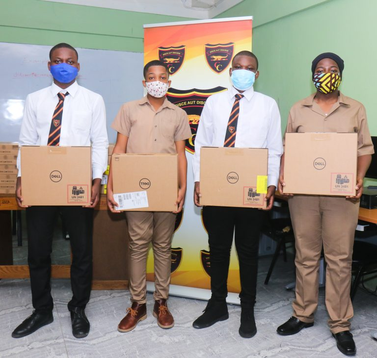 Cornwall College students pose with the donated labtops.